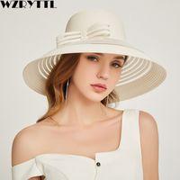 Wholesale black white straw hat men online - 2019 New Style Women Summer Beach Hat Bow knot Accent Ladies Striped Wide Brim Floppy Sun Hat Paper Straw