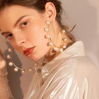 ingrosso grandi aghi-Circa 7,8 centimetri di grandi orecchini in metallo dorato intarsio perla artificiale semicerchio argento 925 ago esagerato fase grandi orecchini a cerchio