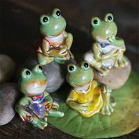 ingrosso figurine piombo-Figurine divertenti della rana Salone Casa da collezione Ceramiche carine Decor Artigianato Ornamento Camera Bella decorazione regalo di nozze tavolo
