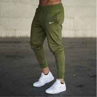 ingrosso pantaloni casual per gli uomini grigi-2018 Nuovi uomini Joggers Pantaloni di marca maschile Pantaloni casual Pantaloni sportivi Jogger grigio Casual cotone elastico GYMS Fitness Workout pan
