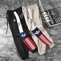 corredores para hombres al por mayor-Pantalón de carga para hombre diseñador Hip Hip Streetwear marca deportiva para hombre Pantalones Joggers Pantalón deportivo de diseño para mujer Pantalones casuales Pantalón talla S-2XL