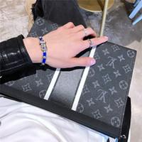 ingrosso pacchetto di mano-hotsale designer di marca nuove borse unisex fashion designer di moda a mano confezioni valigette in vera pelle di alta qualità