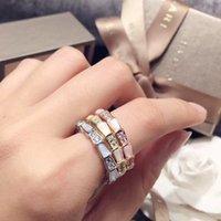 weiße schlangenband großhandel-Neue ankunft markenname 316l titanium stahl schlange form band ring mit diamanten und weißen schale liebhaber ring größe für frauen und männer schmuck g