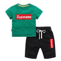 erkek pantolon markaları toptan satış-Bebek Erkek Ve Kız Tasarımcı T-Shirt Ve Şort Takım Marka Eşofman Çocuklar Giyim Seti Sıcak Satmak Moda Yaz Çocuk giyim