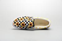 zapatos casuales de marca al por mayor-A estrenar color a juego pequeño Daisy tablero de ajedrez lienzo patchwork hombre perezoso un pedal moda casual zapatos de tablero