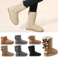 pelze für mädchen großhandel-ugg boots 2020 neue Designer Stiefel Australien Frauen Mädchen klassische Schneeschuhe Bowtie Knöchel kurze Bogen Pelzstiefel für Winter schwarz Chestnut Mode Größe 36-41
