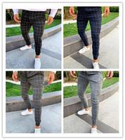 pantalones masculinos recién llegados al por mayor-Moda Plaid Pantalones de diseñador para hombre impresos masculinos con cordón pantalones de lápiz Pantalones para hombre ocasionales Nueva llegada