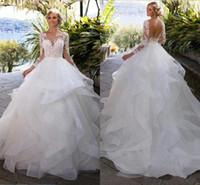 vestido de novia de dos piezas en la foto al por mayor-Capas Ruffle Faldas Sin espalda Vestidos de boda Ilusión Manga larga Apliques Vestidos de bola Vestidos de boda nupciales Árabe Vintage