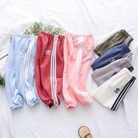 pantalones de niñas de color al por mayor-Pantalones de diseñador para niños 2019 Nueva moda Pantalones de chándal de color liso Pantalones con estampado informal Lindas rayas Sportwear Chicas Niños Multicolor Opcional