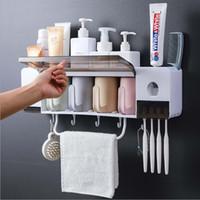 portavasos montado en la pared baño al por mayor-Juego multifuncional de cepillo de dientes para baño con tazas y dispensador automático de pasta de dientes, sistema de almacenamiento de cepillo de dientes eléctrico montado en la pared