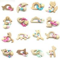 bébé jouet perles achat en gros de-Anneaux de dentition de bébé de qualité alimentaire en bois de hêtre anneau de dentition dents jouets à mâcher douche jouer à mâcher rondes perles en bois B11