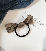 ingrosso arco d'arte-Moda Hair Belt Cloth Art Semplice Bow Tie Hair Loop Cravatta in pelle Tie capelli testa corda