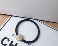 laços elásticos de alta qualidade venda por atacado-Alta qualidade Coréia brilho cores anel de cabelo moda impressão faixas de cabelo cabeça corda amarrar o laço do cavalo cauda do cavalo elástico durável e resistente 10 pcs