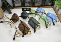 óculos de sol dourados venda por atacado-Nova marca de moda designer de moldura de metal sem aro de ouro vintage simples espelho óculos buzina de búfalo óculos de sol lunetas com caixa