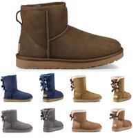 plataforma botas curtas mulheres venda por atacado-UGG uggs 2019 Designer De Luxo Do Vintage Austrália mulheres botas de neve de inverno clássico tornozelo calça sapatos de pelica curto bow boot preto Chestnut tênis de plataforma