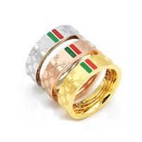 kırmızı çiftler yüzükler toptan satış-Tanınmış marka yüksek kalite kırmızı yeşil taş titanyum yüzük moda klasik çift erkek kadın nişan yüzüğü düğün takı
