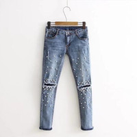 medias de mujer agujeros al por mayor-Moda azul claro agujero rayado Jeans mujer pantalones ajustados perla decoración Retro Jeans para ropa de mujer