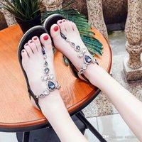 женские сексуальные плоские сандалии оптовых-Цветочные сексуальные сандалии женские Xiaping и 2019 новый чешский национальный стиль с плоским дном курорт пляжная обувь