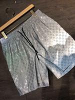 patrón de pantalón de hombres al por mayor-2019ss nuevo diseñador de lujo casual pantalones cortos para hombre patrón de serpiente bordado de flores pantalones cortos de natación de moda de la calle alta Medusa pantalones de playa