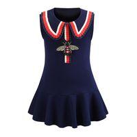 vestido de rayas para las niñas al por mayor-Vestido de las niñas Nuevos Niños Abejas Bordado Algodón Princesa Vestidos niños Raya Solapa Vestido Sin Mangas INS Diseñador de moda ropa para niños