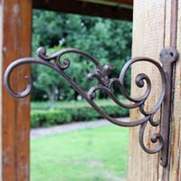 ingrosso piante da giardino decorazione-4 Decorazioni da giardino in ferro battuto con staffa decorativa per piante sospese Lantern Birdcage Flower Pots Appendini in metallo marrone
