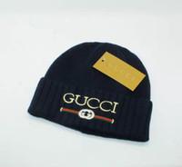beanies de crianças amarelas venda por atacado-Novo Design feminino chapéu de inverno bonito chapéu de malha gancho contas bola polo mão quente chapéu senhoras de acrílico de alta qualidade