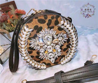 perla entrega gratuita al por mayor-Nueva bolsa de perlas de diamantes de lujo europeo tendencia de la moda coreano Baitao a horcajadas bolso con estampado de leopardo, entrega gratuita