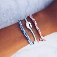 braceletes de corda para mulheres venda por atacado-Feitas à mão Shell Corda Pulseira Bohemia Estilo Homens Mulheres Universal Pulseiras Jóias Novidade Itens Originalidade Presente Do Partido TTA704