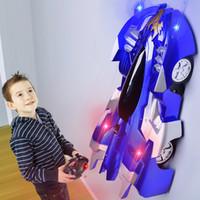 brinquedos de carros de parede venda por atacado-Eletricidade Controle Remoto Escalada na Parede Do Carro 4CH RC Car Recarregável Luzes LED de 360 Graus de Rotação Stunt Brinquedos Anti gravidade Teto Parede Vermelha