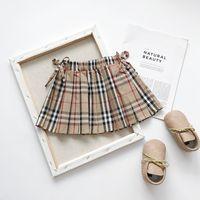 Wholesale tutu skirt cotton dress resale online - Retail kids luxury designer clothes girls bow plaid skirts Classic preppy princess dress pleated skirt Children boutique clothing off