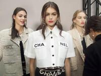 lavage de la soie achat en gros de-19SS Chanel  Office Lady Chemises de travail chanel Femmes Blouses Nouveau Printemps Revers À Manches Longues Poches Avant Boutons En Métal Boutons Lettre Designer Chemise Blanche
