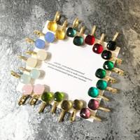 ingrosso orecchino di diamanti giada-2018 Top in materiale ottone disegno orecchino parigi con nature jade e zirconi decorati timbro logo charm orecchino a bottone con diamanti placcato oro 18k