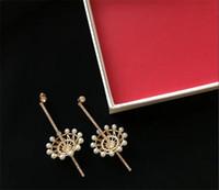 pendientes torcidos al por mayor-Pendientes de lujo Europea joyas de oro de 18 quilates chapado diseñador trenzado perla estilo de línea larga del banquete del partido joyería de la boda de lujo de las mujeres pendientes