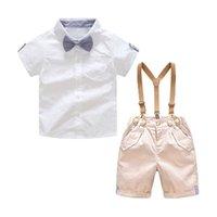 terno de bebê meninos bege venda por atacado-Bonito Da Criança Do Bebê Meninos Cavalheiro Ternos Camisas de Arco Branco e Calções Calções Bege Geral 2 pcs Define Moda Roupas de Verão
