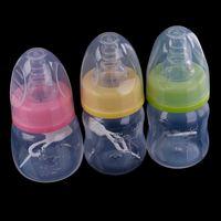 essen monat großhandel-60 ml Mini Milch Fruchtsaft Wasser Fütterung Standard Mund Silikon Nippel Schnuller Trinkflasche Neugeborenes Baby Säuglingspflege