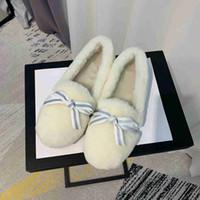 botas de plumas de invierno al por mayor-Zapatos planos de invierno de lana de cuero genuino Botas de nieve cálidas para mujer Botines de piel para mujer Botas de piel peluda de plumas reales Tamaño 35-40