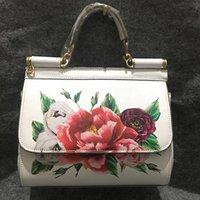 bolsas de impresión de vaca al por mayor-Famosa marca Premium Luxury Lady Bag Flores Imprimir Platino Tote Bolsos blancos femeninos Bolso de cuero de vaca genuino / Bolsos de hombro