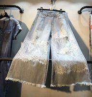 laço de crochet largo venda por atacado-Europeu Denim Calças Mulher 2019 Verão Europeu Nova Costura de Crochê Lace Alta Cintura Larga Pernas Nove Calças Jeans Nancylim