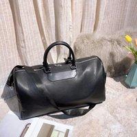 bolsa grande de equipaje negro al por mayor-Negro 51CM las mujeres bolsas de gran capacidad clásicos de la venta caliente hombres de alta calidad de hombro bolsas de lona equipaje de mano Duffel bolsas de viaje