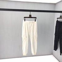 ingrosso uomini bianchi pantaloni bianchi-Stereo nuovi uomini di pantaloni Early Autumn comune Nome Ins vento ricamo in bianco e nero Cuciture cerniera chiusa velluto pantaloni casual 02q45