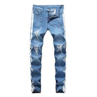 jeans griffés pour hommes achat en gros de-Jeans de créateur pour hommes KANYE WEST Ripped Distressed Long Jean rayé bleu clair Pantalon de mode Pantalon