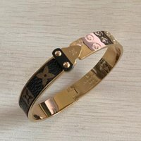 ingrosso braccialetti di braccialetto di freccia-Braccialetto in oro placcato in vera pelle con motivo floreale classico a quattro foglie