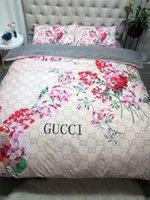 queen-bettwäsche-sets für mädchen großhandel-Mädchen Blumendruck Bettwäsche-Versorgungsmaterialien voller Buchstabe-Art- und Weiselogo-Bett-Abdeckung 4PCS Europa und Amerika Königin-Bettwäschesätze