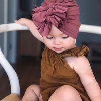ingrosso cappelli di beanie di cotone per i bambini-Berretto di cotone a forma di fiocco disordinato Cappelli di cotone per bebè Bebe Cappello a tre fiocchi Neonato Turbante Annodato Caldo Copricapo Berretto da bambino per ragazzi 18 colori