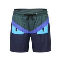 Wholesale eyes matches online - 2019 new hot men and women models summer two color color matching eye print temperament personality couple swimming trunks