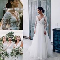 Wholesale wedding dresses v plus size online - Spring Summer Garden Wedding Dresses Deep V Neck Sheer Long Sleeves with Appliques Beads Sequins Boho Bridal Gowns Plus Size
