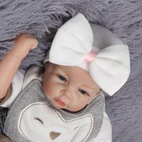 Wholesale winter tires resale online - Newborn Christmas Bow Hats Infant Skull Beanie Winter Warm Striped Ribbon Hat Baby Crochet Knit Caps Bowknot Tire Cap styles LXL623
