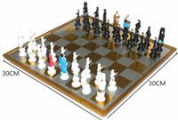 dibujos animados internacionales al por mayor-Juego de ajedrez internacional con tablero de ajedrez Ajedrez magnético Piezas de ajedrez de dibujos animados Fiesta familiar Juguete de viaje Juego de mesa para niños Ajedrez