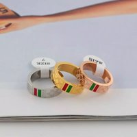 china banda prata venda por atacado-Luxo Designer de Jóias Mulheres Anéis Mens Moda Banda Anéis de Aço Inoxidável Casal Anel Rosa de Ouro Anéis de Noivado de Casamento de Prata