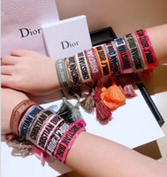 Wholesale red string lucky charms resale online - Top quality rope material String Infinity symbol Lucky Cord Adjustable Bracelet with sewing words and tassel famous brand PS9201